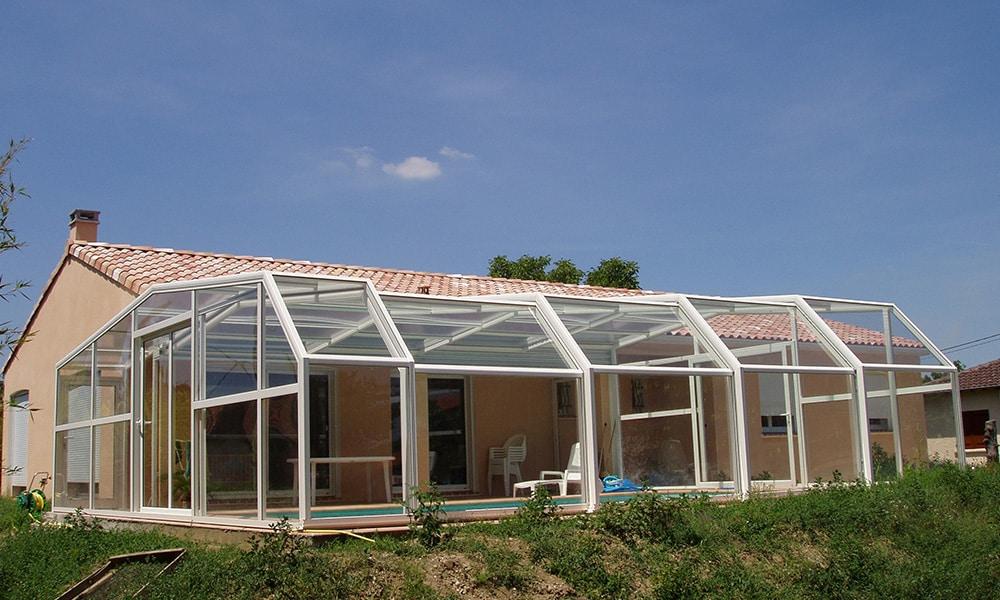 Angebaute Poolüberdachung Fassade - Villeneuve-Tolosane, Frankreich